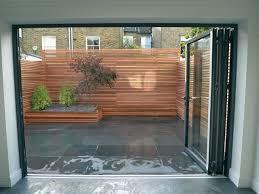 cedar privacy screen slate paving bench minimalist garden london