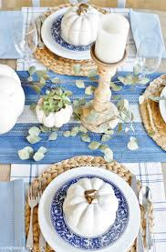 a blue and white thanksgiving table sand and sisal