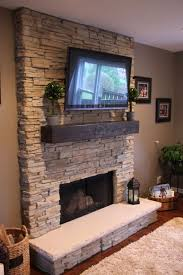 Stone Wall Fireplace   get inspired with this amazing photo of stack stone fireplaces with