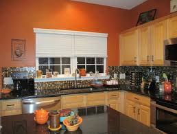burnt orange kitchen black granite countertops glass tile