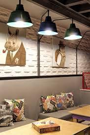 gallery of alaloum board game café triopton architects 9