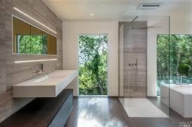 modern master bathroom with wall sconce u0026 limestone tile floors in
