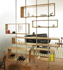 room divider made of bamboo boxes supported by aluminum poles the