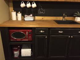 basement kitchenette tinyhouseontheprairie use but i am obsessed with them so i had to make it work before adding the lights and the cabinet hardware the silver faucet stuck out and now it
