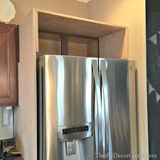how to build a cabinet around a refrigerator building in a fridge with cabinet on top from thrifty decor