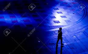 blue light for depression silhouette of a walking man in blue light symbolizing the lonely