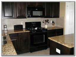 what color appliances go with black cabinets two tone kitchen cabinets ideas concept with modern door