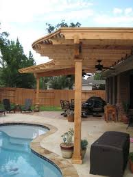 Pool Pergola Ideas by Radius Pergola With Scroll Cuts And Decorative Stamped Concrete On