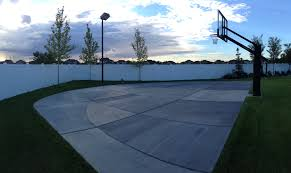 uniquely shaped court allows for the three point arc all the way