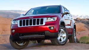 red jeep wallpaper jeep grand cherokee 2011 in red front headlight pose wallpaper