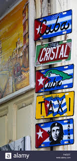 souvenir license plates for sale in tourist shop habana