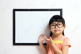 wears a big spectacles posing next to a white board