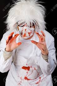scary doctor covered in blood after a gory surgery stock photo