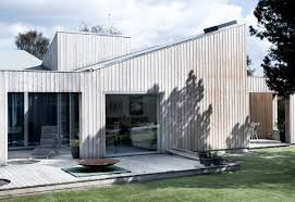 Slanted Roof House Sigurd Larsen U0027s Roof House Features Intersecting Slanted Roofs