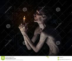 gothic halloween background gothic and halloween theme a man with a candle on his knees with