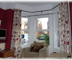How To Put Curtains On Bay Windows Enticing Curtains With Room Bay Plus Window Seat Saving Green