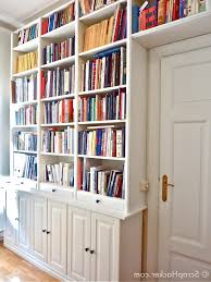 bookcase in white wall paint decoration has ladder and wooden
