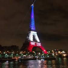 eiffel tower christmas lights as paris mourns terrorist attacks eiffel tower lights up for france