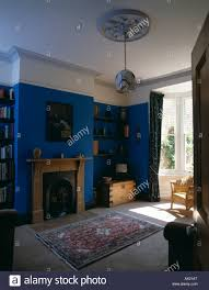 blue livingroom bright blue livingroom with pine fireplace and patterned rug on