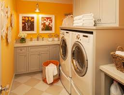 sweet orange paint color for laundry room with baige furniture