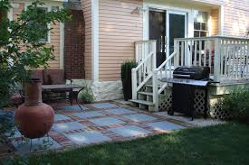 small outdoor kitchen under patio site managed by east coast efx