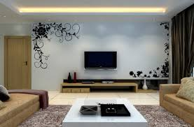 black tv on the white wall with black floral wall panel paint