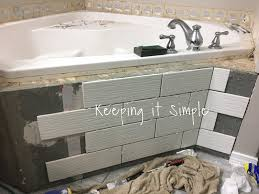 keeping it simple tips on how to tile a corner bathtub using