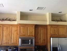 Space Above Kitchen Cabinets Ideas Our Home In Az Has Open Space Above The Kitchen Cabinets Need