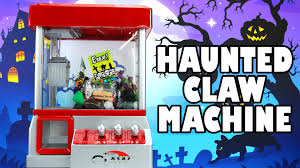 claw machine with halloween candy toys monsters and more