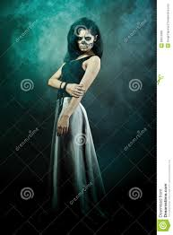 woman with skull face halloween face art royalty free stock