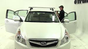 subaru legacy white 2013 installation of a rhino rack heavy duty roof rack on a 2011 subaru