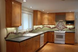 ceramic kitchen backsplash contemporary kitchen with wooden cabinet and black countertop made