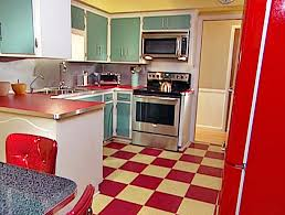 remodel with retro kitchen cabinets and metallic backsplash with