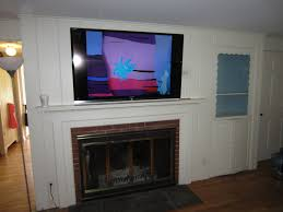 mounting a tv over a brick fireplace fireplace ideas
