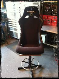my husband up cycled his old race seat into a garage stool the