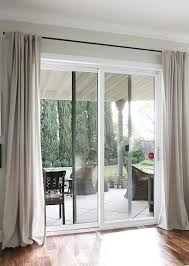sliding door covered with extra long curtains without rods fancy