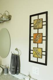 How To Decorate A Large Wall by How To Decorate A Bathroom Without Clutter
