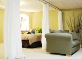 Hanging Curtains From The Ceiling Unfinished Basement Ideas 9 Affordable Tips Bob Vila