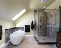 attic bathroom with walk in shower and skylight also freestanding