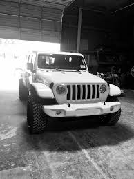 jeep wrangler jacked up matte black flat fenders aftermarket for the jeep jl 2018 jeep wrangler