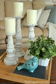 spray painted and distressed 2 yard sale candlesticks diy