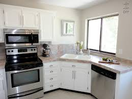 Antique White Kitchen Cabinets Image Of Best Antique White Paint Antique White Kitchen Cabinets With Black Appliances U2013 Awesome