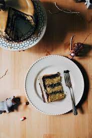 boozy yellow birthday cake with chocolate frosting and caramelized