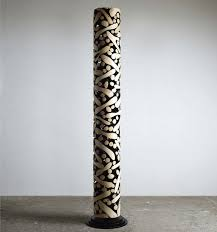 wood sculptures crafted from discarded tree trunks and