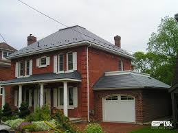 brick house in nova scotia with a metal roof by interlock roofing