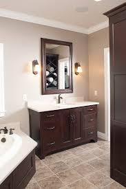 love the dark cabinets with the light marble and tile bathroom
