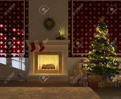 cozy decorated christmas fireplace at night with tree and presents