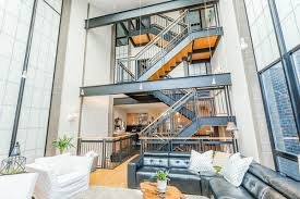 contemporary lincoln park mansion with dramatic steel staircase