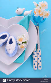 its a boy blue theme baby shower table place setting with heart