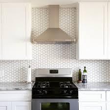 white kitchen cabinets with hexagon backsplash bright white kitchen with a plain and simple backsplash